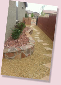Side yard planter landscaping and rock pathway  by Rising Sun Landscaping & Maintenance