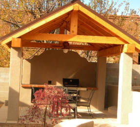 Outdoor kitchen and shelter by Rising Sun Landscaping & Maintenance