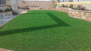 Synthetic lawn, artificial turf in back yard landscaping by Rising Sun Landscaping & Maintenance