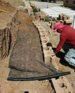 Retaining wall installation by Rising Sun Landscaping & Maintenance
