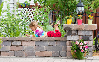 block wall, enjoyable landscaping
