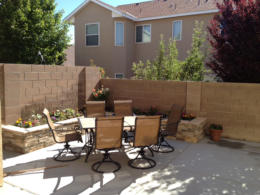 Concete Patio, planter, table chairs by Rising Sun Landscaping & Maintenance