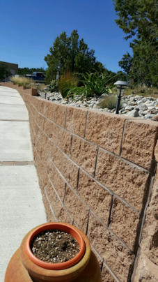 Retaining wall and walkways are benefits in landscaping.